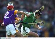 16 September 2001; Limerick's Mark Keane gets away from the challenge of Wexford's Niall Maguire. Limerick v Wexford, All-Ireland U-21 Hurling Final, Semple Stadium, Thurles. Picture credit; Brendan Moran / SPORTSFILE