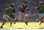 23 September 2001; Joe Bergin of Galway is tackled by Paddy Reyonlds, left, and John McDermott of Meath during the GAA Football All-Ireland Senior Championship Final match between Galway and Meath at Croke Park in Dublin. Photo by Ray McManus/Sportsfile