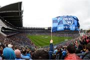 18 September 2016; A Dublin supporter waves a flag during the GAA Football All-Ireland Senior Championship Final match between Dublin and Mayo at Croke Park in Dublin. Photo by Cody Glenn/Sportsfile