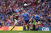 18 September 2016; Cillian O'Connor of Mayo kicks his side's equalising point despite the best efforts of Dublin players Eoghan O'Gara and Darren Daly during the GAA Football All-Ireland Senior Championship Final match between Dublin and Mayo at Croke Park in Dublin. Photo by Brendan Moran/Sportsfile