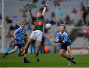 18 September 2016; Tom Coleman, Two Mile House N.S, Naas, Co. Kildare, representing Dublin, in action against Dara O'Callaghan, Kilcummin, Killarney, Co. Kerry, representing Mayo during the INTO Cumann na mBunscol GAA Respect Exhibition Go Games at the GAA Football All-Ireland Senior Championship Final match between Dublin and Mayo at Croke Park in Dublin. Photo by Seb Daly/Sportsfile