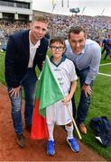 18 September 2016; eir GAA flagbearer Adam Moran, age 9, from Drumcondra, Co. Dublin, pictured with eir GAA ambassadors Ciaran Whelan and Tomás Ó Sé at the All-Ireland Senior Football Final between Dublin and Mayo at Croke Park in Dublin.   Photo by Brendan Moran/Sportsfile