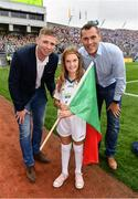 18 September 2016; eir GAA flagbearer Fianna Hickey, age 8, from Waterford, pictured with eir GAA ambassadors Ciaran Whelan and Tomás Ó Sé at the All-Ireland Senior Football Final between Dublin and Mayo at Croke Park in Dublin.   Photo by Brendan Moran/Sportsfile