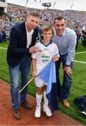 18 September 2016; eir GAA flagbearer Brendan O'Connell, age 11, from Blackrock, Co. Dublin, pictured with eir GAA ambassadors Ciaran Whelan and Tomás Ó Sé at the All-Ireland Senior Football Final between Dublin and Mayo at Croke Park in Dublin.   Photo by Brendan Moran/Sportsfile