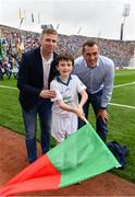 18 September 2016; eir GAA flagbearer Michael Charles, age 10, from Ballina, Co. Mayo, pictured with eir GAA ambassadors Ciaran Whelan and Tomás Ó Sé at the All-Ireland Senior Football Final between Dublin and Mayo at Croke Park in Dublin.   Photo by Brendan Moran/Sportsfile
