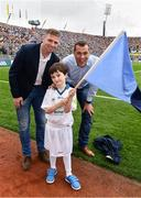 18 September 2016; eir GAA flagbearer Ryan Shields, age 11, from Dublin, pictured with eir GAA ambassadors Ciaran Whelan and Tomás Ó Sé at the All-Ireland Senior Football Final between Dublin and Mayo at Croke Park in Dublin.   Photo by Brendan Moran/Sportsfile