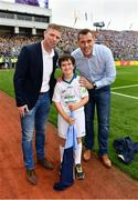 18 September 2016; eir GAA flagbearer Ryan Wickham, age 9, from Dublin, pictured with eir GAA ambassadors Ciaran Whelan and Tomás Ó Sé at the All-Ireland Senior Football Final between Dublin and Mayo at Croke Park in Dublin.   Photo by Brendan Moran/Sportsfile