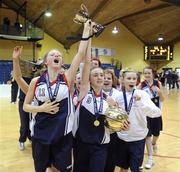 26 January 2011; St. Vincents Secondary School, Cork, players Edel Thornton, 11, and Megan O'Leary celebrate with the cup. Basketball Ireland Girls U16A Schools Cup Final, Calasanctius College, Oranmore, Galway v St. Vincents Secondary School, Cork, National Basketball Arena, Tallaght, Dublin. Picture credit: Stephen McCarthy / SPORTSFILE