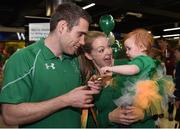 21 September 2016; Jason Smyth of Ireland shows his gold medal to his 10-month-old daughter Evie, alongside his wife Elise, all from Belfast, which he won in the Men's 100m T13 Final during their homecoming from the Rio 2016 Paralympic Games at Dublin Airport in Dublin. Photo by Cody Glenn/Sportsfile