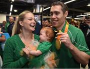 21 September 2016; Gold medallist Jason Smyth of Ireland with his 10-month-old daughter Evie and his wife Elise, all from Belfast, who won gold in the Men's 100m 13 Final, during their homecoming from the Rio 2016 Paralympic Games at Dublin Airport in Dublin. Photo by Cody Glenn/Sportsfile