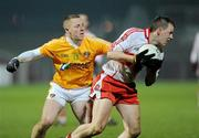 29 January 2011; Brian McCallion, Derry, in action against Paddy Cunningham, Antrim. Barrett Sports Lighting Dr. McKenna Cup Semi-Final, Derry v Antrim, Celtic Park, Derry. Picture credit: Oliver McVeigh / SPORTSFILE
