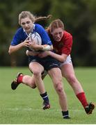 24 September 2016; Anna Doyle of Leinster is tackled by Aoife O'Shaughnessy of Munster during the U18 Girls Interprovincial Series match between Leinster and Munster at Seapoint RFC in Dublin. Photo by Matt Browne/Sportsfile