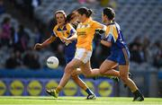 25 September 2016; Clare Timoney of Antrim scores her side's first goal despite the best efforts of Jacinta Brady, left, and Claire Farrell of Longford during the TG4 Ladies Football All-Ireland Junior Football Championship Final match between Antrim and Longford at Croke Park in Dublin.  Photo by Brendan Moran/Sportsfile