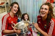 26 September 2016; Áine McInerney, age 4, from Mountainpole, Kells, in Meath, and Cork players Eimear Meaney, left, and Maeve O'Sullivan with the Brendan Martin cup during a visit to Temple Street Children's Hospital, in Dublin. Photo by Piaras Ó Mídheach/Sportsfile