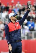 27 September 2016; 23 time Olympic Gold medalist Michael Phelps acknowledges the gallery during the Celebrity Matches at The 2016 Ryder Cup Matches at the Hazeltine National Golf Club in Chaska, Minnesota, USA. Photo by Ramsey Cardy/Sportsfile