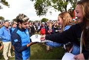 27 September 2016; One Direction singer Niall Horan signs autographs for fans before his round of the Celebrity Matches at The 2016 Ryder Cup Matches at the Hazeltine National Golf Club in Chaska, Minnesota, USA. Photo by Ramsey Cardy/Sportsfile