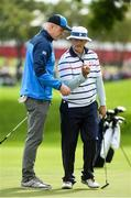 27 September 2016; Former Ireland and Munster rugby player Paul O'Connell of Europe in conversation with Actor Bill Murray of USA during the Celebrity Matches at The 2016 Ryder Cup Matches at the Hazeltine National Golf Club in Chaska, Minnesota, USA. Photo by Ramsey Cardy/Sportsfile