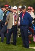 30 September 2016; JP McManus, left, and Dermot Desmond look on during the morning Foursomes Matches between Rory McIlroy and Andy Sullivan of Europe and Phil Mickelson and Rickie Fowler of USA at The 2016 Ryder Cup Matches at the Hazeltine National Golf Club in Chaska, Minnesota, USA. Photo by Ramsey Cardy/Sportsfile
