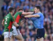1 October 2016; Brendan Harrison and Donal Vaughan of Mayo, centre, tussle with Diarmuid Connolly of Dublin during the GAA Football All-Ireland Senior Championship Final Replay match between Dublin and Mayo at Croke Park in Dublin. Photo by Paul Mohan/Sportsfile