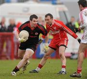6 February 2011; Jonathan Curran, Tyrone, in action against Paddy Bradley, Derry. Allianz Football League Division 2 Round 1, Derry v Tyrone, Celtic Park, Derry. Picture credit: Oliver McVeigh  / SPORTSFILE