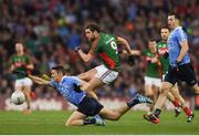 1 October 2016; Darren Daly of Dublin blocks the kick of Tom Parsons of Mayo which proved to be Mayo's final attack during the GAA Football All-Ireland Senior Championship Final Replay match between Dublin and Mayo at Croke Park in Dublin. Photo by Stephen McCarthy/Sportsfile