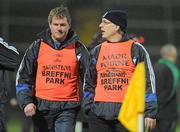 9 February 2011; Cavan joint managers, Val Andrews, right, and Terry Hyland chat over tactics on the sideline. Barrett Sports Lighting Dr. McKenna Cup Semi-Final, Tyrone v Cavan, Brewster Park, Enniskillen, Co. Fermanagh. Picture credit: Oliver McVeigh / SPORTSFILE