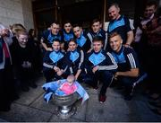 2 October 2016; Dublin players and manager Jim Gavin with Kyra Hutchins, age 5 months, from Wexford, and the Sam Maguire cup during the Dublin team's visit to the Our Lady's Children's Hospital in Crumlin, Dublin.  Photo by Piaras Ó Mídheach/Sportsfile