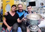 2 October 2016; Dublin manager Jim Gavin, centre, with Luke Norton, 13, his mother Leona Norton, both from Finglas West, Co Dublin, and the Sam Maguire Cup during their visit to the Temple Street Children's Hospital in Dublin.  Photo by Sam Barnes/Sportsfile