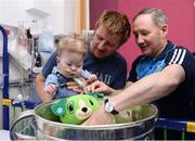 2 October 2016;  Dublin manager Jim Gavin, with  Killian Fox, age 15 months, and father Jason Fox from Rossinver, Co Leitrim with the Sam Maguire cup during their visit to the Temple Street Children's Hospital in Dublin.  Photo by Sam Barnes/Sportsfile