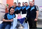 2 October 2016; Eva Maher, 10 weeks old, from Swords, Co Dublin with Dublin Manager Jim Gavin, right, and a selection of players, including Cormac Costello, left, and the Sam Maguire cup during their visit to the Temple Street Children's Hospital in Dublin.  Photo by Sam Barnes/Sportsfile