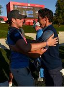 30 September 2016; Niall Horan congratulates Rory McIlroy of Europe after winning his Fourball Match on the 16th hole against Dustin Johnson and Matt Kuchar of USA at The 2016 Ryder Cup Matches at the Hazeltine National Golf Club in Chaska, Minnesota, USA. Photo by Ramsey Cardy/Sportsfile