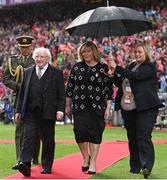 25 September 2016; President of Ireland Michael D Higgins and Marie Hickey, President, LGFA, walk out to meet the teams before the Ladies Football All-Ireland Senior Football Championship Final match between Cork and Dublin at Croke Park in Dublin.  Photo by Brendan Moran/Sportsfile