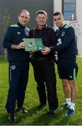 5 October 2016; Republic of Ireland manager Martin O'Neill and Seamus Coleman with Sportsfile photographer David Maher, centre, with Sportsfile's new book, The Republic of Ireland at Euro 2016 - A Pictorial Record, following squad training at the FAI National Training Centre in Abbotstown, Dublin. Remember the excitement of Euro 2016 when the Boys in Green did the country proud? As Christmas approaches the Sportsfile photographic team has compiled a 54-page photographic record of those memorable June days in France. All the goals are included and naturally there are also some great pictures of well-behaved Irish supporters as they did their bit for Ireland of the Welcomes. All the action and fans zone celebrations have now been brought together in a beautifully illustrated book titled The Republic of Ireland at Euro 2016. From Wes Hoolahan's brilliant strike in the opening game against Sweden in Paris to Bordeaux and a 3-0 defeat to Belgium. Then Robbie Brady's perfectly timed header as Martin O'Neill's team beat Italy in Lille to progress to the round of 16, where the dream eventually ended against France in Lyon. With captions by Sean Creedon and supported by CityJet the book is available in book shops and online at http://www.sportsfile.com . (€14.95 plus postage and packaging).  Photo by Seb Daly/Sportsfile