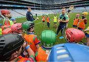 8 October 2016; Kilkenny hurler Richie Hogan, right, and Waterford hurler Mauirce Shanahan teach technique to members of the Shamrocks GAA Club from Co Offaly at Croke Park today which played host to some of Ireland's most talented hurlers, along with over 500 children, who lined-out to learn tips and skills from their hurling heroes as part of Centra's Live Well hurling initiative. The participating children, who experienced a once in a lifetime opportunity, came from 12 lucky GAA clubs who each claimed their very special spot by winning a Live Well hurling challenge during the summer. Croke Park, Dublin. Photo by Cody Glenn/Sportsfile