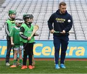 8 October 2016; Kilkenny hurler Richie Hogan teaches proper form to youth members of O'Loughlin's Gaels GAA Club, from Co Kilkenny, at Croke Park today which played host to some of Ireland's most talented hurlers, along with over 500 children, who lined-out to learn tips and skills from their hurling heroes as part of Centra's Live Well hurling initiative. The participating children, who experienced a once in a lifetime opportunity, came from 12 lucky GAA clubs who each claimed their very special spot by winning a Live Well hurling challenge during the summer. Croke Park, Dublin. Photo by Cody Glenn/Sportsfile