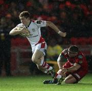 18 February 2011; Paddy Jackson, Ulster, goes past the tackle of Rhys Thomas, Scarlets. Celtic League, Scarlets v Ulster, Parc Y Scarlets, Llanelli, Wales. Picture credit: Steve Pope / SPORTSFILE