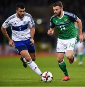 8 October 2016; Stuart Dallas of Northern Ireland in action against Marco Berardi of San Marino during the FIFA World Cup Group C Qualifier match between Northern Ireland and San Marino at Windsor Park in Belfast. Photo by David Fitzgerald/Sportsfile