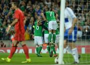 8 October 2016; Steve Davis of Northern Ireland, 8, celebrates with team mates after scoring his sides first goal from a penalty during the FIFA World Cup Group C Qualifier match between Northern Ireland and San Marino at Windsor Park in Belfast. Photo by Oliver McVeigh/Sportsfile