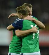 8 October 2016; Jamie Ward of Northern Ireland centre, celebartes with Niall McGinn after scoring his sides third goal during the FIFA World Cup Group C Qualifier match between Northern Ireland and San Marino at Windsor Park in Belfast. Photo by Oliver McVeigh/Sportsfile