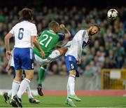8 October 2016; Josh Magennis of Northern Ireland in action against Fabio Vitaioli of San Marino during the FIFA World Cup Group C Qualifier match between Northern Ireland and San Marino at Windsor Park in Belfast. Photo by Oliver McVeigh/Sportsfile
