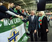 """8 October 2016; Pat Jennings former Northern Ireland great and Mary Peters former Olympic Gold Medal winner during the """"Lap of legends"""" before the FIFA World Cup Group C Qualifier match between Northern Ireland and San Marino at Windsor Park in Belfast. Photo by Oliver McVeigh/Sportsfile"""