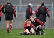 20 February 2011; A dejected Elaine O'Shea, University College Cork, is consoled at the end of the game by a team-mate after defeat to  Waterford IT. Ashbourne Cup Final, University College Cork v Waterford IT, Pearse Stadium, Salthill, Galway. Picture credit: David Maher / SPORTSFILE
