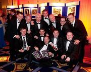 """18 February 2011; Sportsfile staff photographers David Maher, from Kilcock, Co. Kildare, and Brendan Moran, from Tralee Co. Kerry, celebrate with their Sportsfile colleagues and their awards at the Press Photographers Association of Ireland -  AIB Photojournalism Awards 2011. Back row, from left, Paul Mohan, Oliver McVeigh, Ray McManus, Stephen McCarthy, Denis O'Callaghan, General Manager, Retail Banking, AIB Bank, Brian Lawless and Diarmuid Greene with, front, from left, David Maher, Matt Browne, Michael Cullen, Brendan Moran and Barry Cregg. David Maher won 2nd place in the Sports Portfolio category with the judges citation reading """"The photographer demonstrates how shooting against the light can on occasion pay-off very well; throughout there is great use of light and great observation."""" Brendan Moran won 2nd place in the Environmental category with a picture titled """"Snow Seats"""" a view of empty seats in Croke Park stadium covered in snow during the recent bad weather in December last, with the judges citation reading """"The absence of people helps tell the story in a very graphic way while keeping the image simple and powerful. The strength of the picture comes from its very simplicity."""" This year, over 2,010 images were entered by 123 photographers from around the country, across nine categories - news, daily life, sports action, sports portfolio, portrait, environment, politics, arts & entertainment and reportage. The AIB Photojournalism Exhibition, featuring 122 prints, opens in AIB Bank, Cornelscourt, on Tuesday, 22nd February 2011. It will then go on tour, visiting selected AIB branches and other venues nationwide. Masterclasses for schools, camera clubs and photography students will also be held in locations throughout the country over the coming months. Burlington Hotel, Dublin. Picture credit: Shane O'Neill / Fennells"""