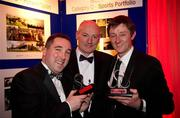 """18 February 2011; Sportsfile staff photographers David Maher, right, from Kilcock, Co. Kildare, and Brendan Moran, left, from Tralee Co. Kerry, with Denis O'Callaghan, General Manager, Retail Banking, AIB Bank, and their awards at the Press Photographers Association of Ireland -  AIB Photojournalism Awards 2011. David Maher won 2nd place in the Sports Portfolio category with the judges citation reading """"The photographer demonstrates how shooting against the light can on occasion pay-off very well; throughout there is great use of light and great observation."""" Brendan Moran won 2nd place in the Environmental category with a picture titled """"Snow Seats"""" a view of empty seats in Croke Park stadium covered in snow during the recent bad weather in December last, with the judges citation reading """"The absence of people helps tell the story in a very graphic way while keeping the image simple and powerful. The strength of the picture comes from its very simplicity."""" This year, over 2,010 images were entered by 123 photographers from around the country, across nine categories - news, daily life, sports action, sports portfolio, portrait, environment, politics, arts & entertainment and reportage. The AIB Photojournalism Exhibition, featuring 122 prints, opens in AIB Bank, Cornelscourt, on Tuesday, 22nd February 2011. It will then go on tour, visiting selected AIB branches and other venues nationwide. Masterclasses for schools, camera clubs and photography students will also be held in locations throughout the country over the coming months. Burlington Hotel, Dublin. Picture credit: Ray McManus / SPORTSFILE"""