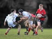 7 February 2011; Gary Power, CUS, evades the tackle of Daire Henderson, Presentation College Bray. Fr Godfrey Cup Quarter-Final Replay, CUS v Presentation College Bray, St. Columba's College, Whitechurch, Dublin. Picture credit: Stephen McCarthy / SPORTSFILE