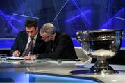13 October 2016; Football analysts Dessie Dolan, left, and Joe Brolly study the Munster draw ahead of the 2017 GAA Provincial Senior Football and Hurling Championships. RTE Studios, Donnybrook, Dublin. Photo by Brendan Moran/Sportsfile