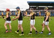16 October 2016; Ballyea players Paul Flanagan, James Murphy, Tony Kelly and Niall Deasy walk behind the Tulla Pipe Band during the pre-match parade during the Clare County Senior Club Hurling Championship Final between Clonlara and Ballyea at Cusack Park in Ennis, Co. Clare. Photo by Diarmuid Greene/Sportsfile