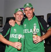 2 March 2011; Ireland's William Porterfield, left, and team-mate Trent Johnson celebrate after their side's victory over England. 2011 ICC Cricket World Cup, hosted by India, Sri Lanka and Bangladesh, Bangalore, India. Picture credit: Barry Chambers / Cricket Ireland / SPORTSFILE