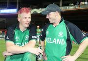 2 March 2011; Ireland's Kevin O'Brien, left, who hit the quickest hundred in World Cup history, celebrates with team-mate Niall O'Brien after their side's victory over England. 2011 ICC Cricket World Cup, hosted by India, Sri Lanka and Bangladesh, Bangalore, India. Picture credit: Barry Chambers / Cricket Ireland / SPORTSFILE