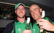 2 March 2011; Ireland's John Mooney, left, and team-mate Trent Johnson celebrate after their side's victory over England. 2011 ICC Cricket World Cup, hosted by India, Sri Lanka and Bangladesh, Bangalore, India. Picture credit: Barry Chambers / Cricket Ireland / SPORTSFILE